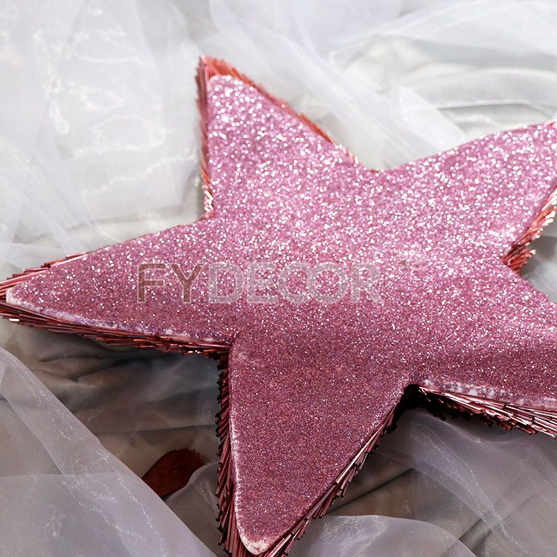 Pink star hanging ornament with glittering tube for Christmas decoration and celebration